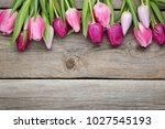 bouquet of tulips on grey... | Shutterstock . vector #1027545193