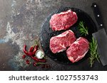 raw beef meat. fresh steaks on... | Shutterstock . vector #1027553743