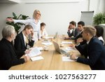 angry senior woman boss firing... | Shutterstock . vector #1027563277