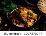 pumpkin curry chicken over... | Shutterstock . vector #1027570747
