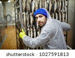 young man in coveralls and... | Shutterstock . vector #1027591813