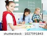 diligent schoolgirl looking at... | Shutterstock . vector #1027591843