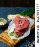 raw beef meat on a wooden... | Shutterstock . vector #1027595797