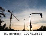 crane silhouette on urban... | Shutterstock . vector #1027615633