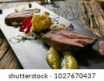 sliced roast beef. | Shutterstock . vector #1027670437