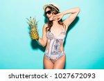 young beautiful woman in bikini ... | Shutterstock . vector #1027672093