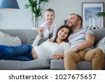 photo of happy parents with... | Shutterstock . vector #1027675657