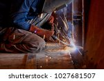 welder working at the factory ... | Shutterstock . vector #1027681507