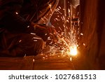 welder working at the factory ... | Shutterstock . vector #1027681513
