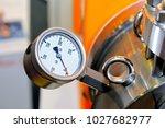 pressure gauge on a blurry... | Shutterstock . vector #1027682977