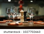 wooden table served with plates ... | Shutterstock . vector #1027702663