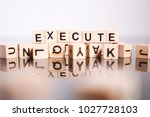 execute word cube on reflection | Shutterstock . vector #1027728103