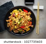 plate of noodles with meat and... | Shutterstock . vector #1027735603