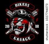 tiger biker with spark plugs.... | Shutterstock .eps vector #1027746073