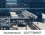 a large oil and gas refinery in ... | Shutterstock . vector #1027758907