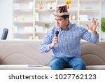 funny man singing songs in... | Shutterstock . vector #1027762123