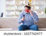 funny man singing songs in... | Shutterstock . vector #1027762477