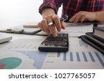 business team meeting present... | Shutterstock . vector #1027765057