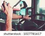 truck driving and radio chat...   Shutterstock . vector #1027781617