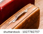 vintage brown traveling luggage.... | Shutterstock . vector #1027782757