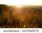sunrise and lens flare over a... | Shutterstock . vector #1027830973
