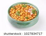chana mmasala spicy chickpea... | Shutterstock . vector #1027834717