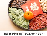 Small photo of Chinese snack tray with red packet word mean luck