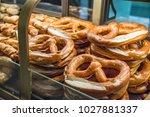 freshly baked pretzels arranged ... | Shutterstock . vector #1027881337