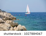 sea. white sailing yacht and a... | Shutterstock . vector #1027884067