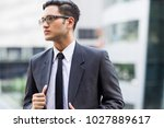 young asian officer waiting for ...   Shutterstock . vector #1027889617