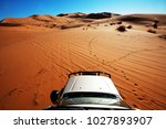 4x4 vehicle driving off road in ... | Shutterstock . vector #1027893907