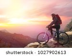 biker riding on bicycle in... | Shutterstock . vector #1027902613