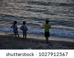 Kids Watching The Sunset At Th...