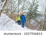 woman and man are having walk... | Shutterstock . vector #1027936813