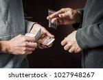 hand of addict man with money...   Shutterstock . vector #1027948267