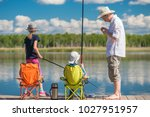 father teaches his children to... | Shutterstock . vector #1027951957