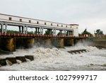 water rushing through gates at... | Shutterstock . vector #1027999717