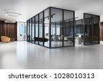 open space office corridor with ... | Shutterstock . vector #1028010313