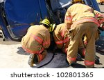Firefighters work on an extrication using a hydraulic rescue tool - stock photo