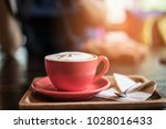 coffee latte on table in cafe... | Shutterstock . vector #1028016433