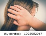 Small photo of Woman with earache is holding her aching ear - body pain concept - retro style