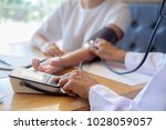 patient listening intently to a ...   Shutterstock . vector #1028059057