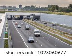 afternoon traffic on a4... | Shutterstock . vector #1028060677