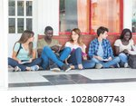 group of multi ethnic teenagers ... | Shutterstock . vector #1028087743