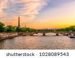 sunset view of eiffel tower and ... | Shutterstock . vector #1028089543
