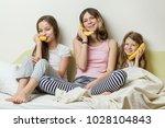 sister children in pajamas play ... | Shutterstock . vector #1028104843
