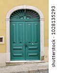 elegant green wooden door in... | Shutterstock . vector #1028135293