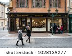 Small photo of Prague, Czech Republic- February 18, 2018: People are walking on the streat near the House of the Black Madonna which is a cubist building in the Old Town area of Prague, Czech Republic