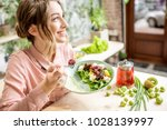 young woman eating healthy food ... | Shutterstock . vector #1028139997