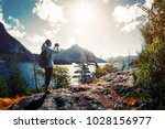 woman hiker takes a pictures of ... | Shutterstock . vector #1028156977
